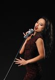 Beautiful brunette woman singing. Picture of a Beautiful brunette woman singing stock photo