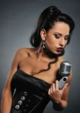 Beautiful brunette woman singing. Picture of a Beautiful brunette woman singing stock photos