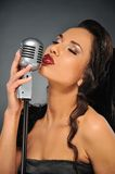 Beautiful brunette woman singing. Picture of a Beautiful brunette woman singing stock photography