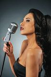Beautiful brunette woman singing. Picture of a Beautiful brunette woman singing stock images