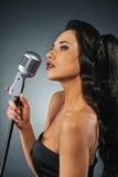 Beautiful brunette woman singing Stock Images