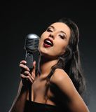 Beautiful brunette woman singing royalty free stock images