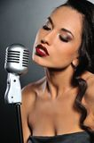 Beautiful brunette woman singing Stock Photography