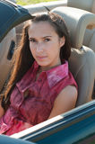 Beautiful brunette woman sitting in the car Stock Images