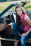Beautiful brunette woman sitting in the car Royalty Free Stock Photos