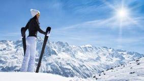 Beautiful brunette woman with ski Royalty Free Stock Photo