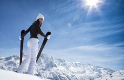 Beautiful brunette woman with ski Stock Photography