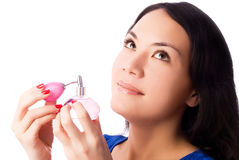 Beautiful brunette woman smells perfume Stock Image