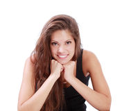 Beautiful brunette woman smiles and props up chin by hands Royalty Free Stock Images
