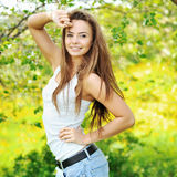 Beautiful brunette woman smiling on sunny summer or spring day o Stock Images