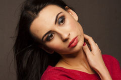 Beautiful brunette woman with smokie eyes poses Royalty Free Stock Photo