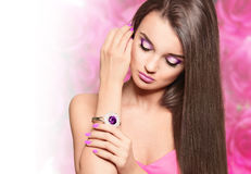 Beautiful brunette woman with straight long hair Stock Photos
