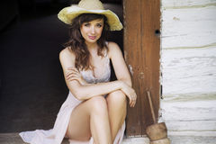 Beautiful brunette woman with straw hat Stock Photo