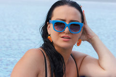 Beautiful brunette woman on summer beach Royalty Free Stock Photo