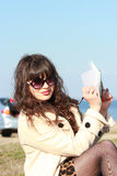 Beautiful brunette woman taking notes on a pad, Camping Royalty Free Stock Photography