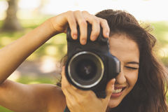 Beautiful brunette woman taking a picture Royalty Free Stock Photos