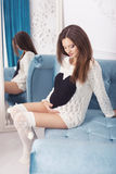 Beautiful brunette woman on a 7th month pregnancy in white sweat Stock Photos