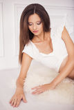 Beautiful brunette woman on a 7th month pregnancy in white under Royalty Free Stock Photos