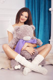 Beautiful brunette woman on a 7th month pregnancy in white under Stock Images