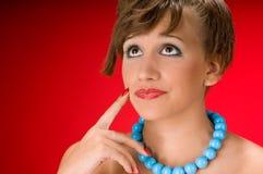 Beautiful brunette woman thinking Stock Image