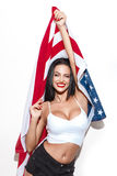 Beautiful brunette woman with usa flag Stock Images
