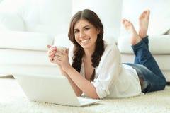 Beautiful brunette woman using laptop Royalty Free Stock Photo