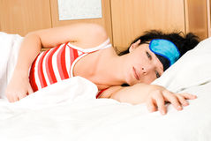 Beautiful brunette woman wakes up Royalty Free Stock Photos