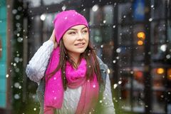 Beautiful brunette woman walking around the city in winter. Snow. Copy Space Concept Lifestyle, Urban, Winter, Vacation, Happy Christmas, New Year Stock Images