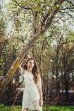 Beautiful brunette woman walking outdoors Royalty Free Stock Photography