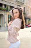 Beautiful brunette woman walking on street at sunny day Royalty Free Stock Photo