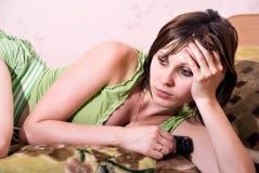 Beautiful brunette woman watching TV stock photography