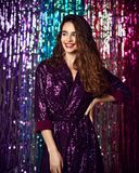 Portrait of a happy smiling girl in a stylish glamorous dress with sequins at a fashion party. royalty free stock photo