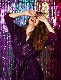 Portrait of a happy smiling girl in a stylish glamorous dress with sequins at a fashion party. stock photo