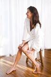 Beautiful brunette woman wearing bathrobe Royalty Free Stock Photos
