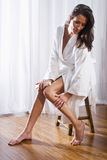 Beautiful brunette woman wearing bathrobe Stock Images