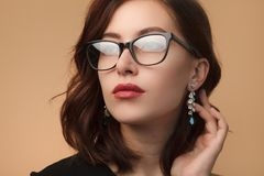 Beautiful woman in black rimmed spectacles stock photo