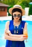 Beautiful brunette woman wearing a blue bikini, enjoying the pool, summer time stock photos