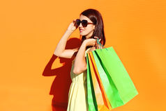 Beautiful brunette woman wearing a dress with shopping bags Stock Photography