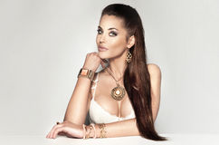 Beautiful brunette woman wearing a lot of jewelry. Stock Image