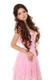 Beautiful brunette woman wearing in pink dress isolated on white Stock Photos