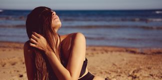 Woman wearing swimsuit posing on the beach Royalty Free Stock Photo
