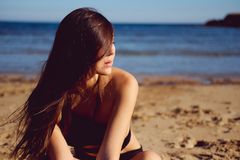 Woman wearing swimsuit posing on the beach Stock Photography