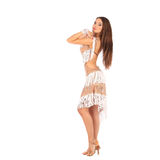 Beautiful brunette woman wearing white dress on light background Stock Photos