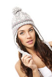 Beautiful brunette woman wearing winter cap Stock Photo