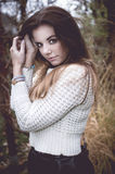 Beautiful brunette woman in white sweater Stock Image