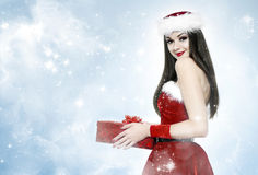 Beautiful Brunette Woman With Gift - Christmas Portrait Royalty Free Stock Images