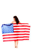 Beautiful brunette woman wrapped into American flag. Stock Photos