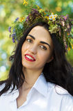 Beautiful brunette woman with a wreath of flowers on head Stock Photography
