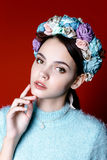 Beautiful brunette woman with a wreath of flowers on her head. Royalty Free Stock Images