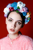 Beautiful brunette woman with a wreath of flowers on her head. Royalty Free Stock Image